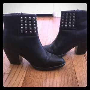 Black booties with silver accents
